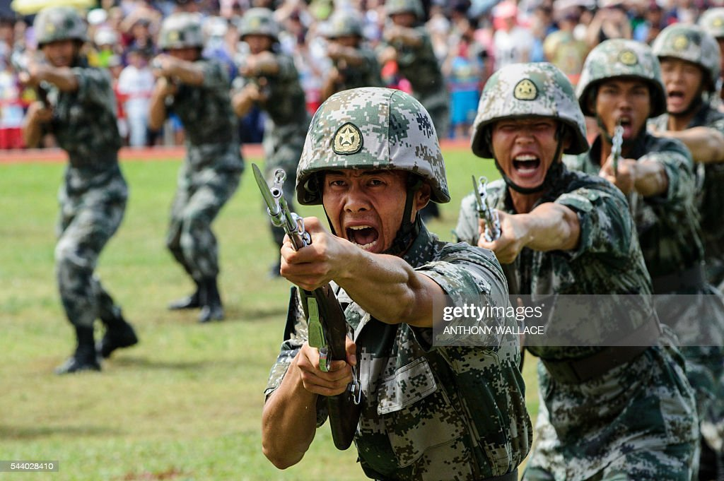 PLA soldiers shout during a demonstration at the open day of the Chinese People's Liberation Army (PLA) Navy Base at Stonecutter Island in Hong Kong on July 1, 2016, to mark the 19th anniversary of the Hong Kong handover to China. / AFP / Anthony Wallace