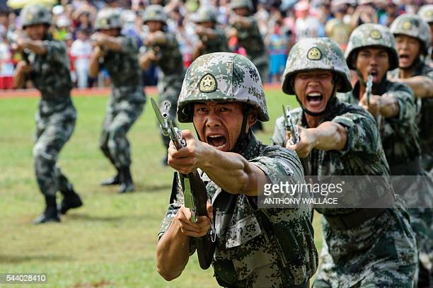 PLA soldiers shout during a demonstration at the open day of the Chinese People's Liberation Army Navy Base at Stonecutter Island in Hong Kong on...