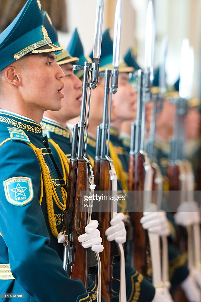 Soldiers sing the Kazakh national anthem during a welcome ceremony on the arrival of British Prime Minister David Cameron to meet with Kazakhstan President Nursultan Nazarbayev at the Presidential Palace on July 1, 2013 in Astana, Kazakhstan. Cameron is visiting Kazakhstan as part of a trade mission; the first ever trip to the country by a serving British Prime Minister, after making an unannounced trip to visit troops in Afghanistan and meeting with the Prime Minister of Pakistan in Islamabad.