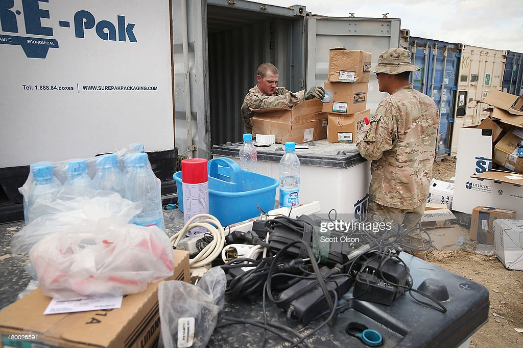 Soldiers sort through shipping containers filled with excess equipment and supplies left by departing units as the U.S. draws down manpower in the 13-year-old war on March 22, 2014 near Gardez, Afghanistan. Although some of the material will be put back into the Army supply chain most of it will be destroyed or sold for scrap. In the past year the U.S. Military has been reducing troops and equipment in Afghanistan as it transitions from a role of combatants, fighting alongside Afghan soldiers, to assisting the Afghan National Security Forces in an advisory role. President Obama recently ordered the Pentagon to develop a contingency plan for a complete pullout from Afghanistan by the end of 2014 if Afghanistan President Hamid Karzai or his successor refuses to sign the Bilateral Security Agreement.