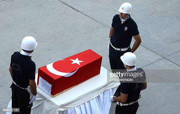 TOPSHOT Soldiers stand around the coffin of a 5 years old victim killed during a bombing blamed on Kurdistan Workers' Party during a funeral in...