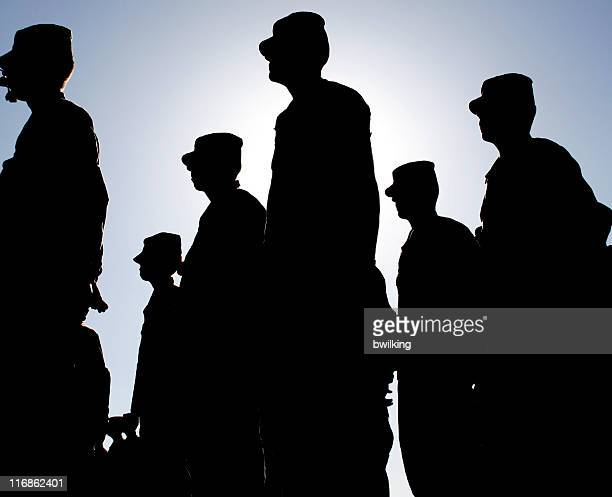 Soldiers Stand at Attention during Sunset