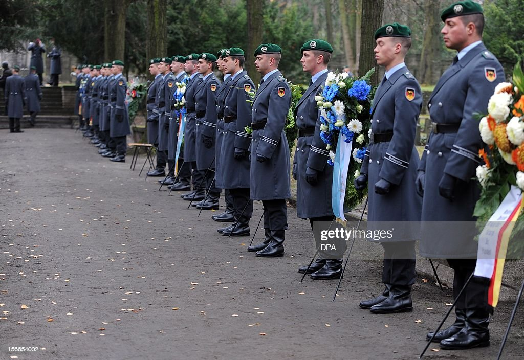 Soldiers stand at the Jewish Cemetery next to wreaths in Berlin Weissensee, on November 18, 2012. The memorial ceremony commemorates the 395 soldiers killed during World War I.
