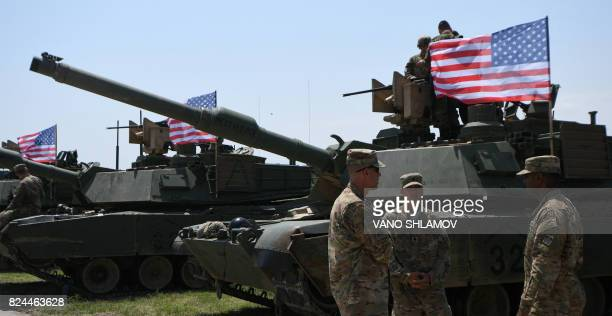 US soldiers stand by Abrams Battle Tanks bearing the US flag prior to the opening ceremony of the joint multinational military exercise 'Noble...