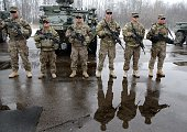 US soldiers stand during a visit of the NATO Secretary General of the airtraffic control center in Karmelava Lithuania on November 21 2014 AFP PHOTO...