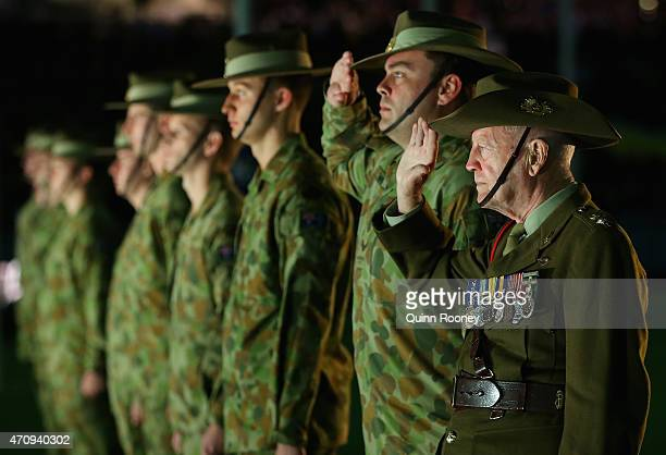 Soldiers stand for a minute silence for Anzac Day during the round four AFL match between the Richmond Tigers and the Melbourne Demons at Melbourne...