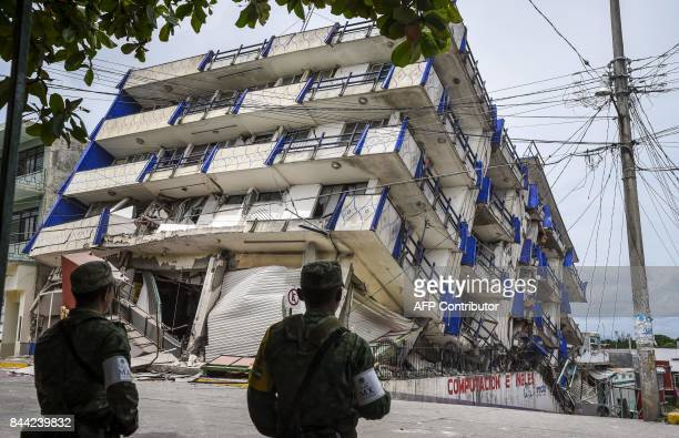 TOPSHOT Soldiers stand guard a few metres away from the Sensacion hotel which collapsed with the powerful earthquake that struck Mexico overnight in...