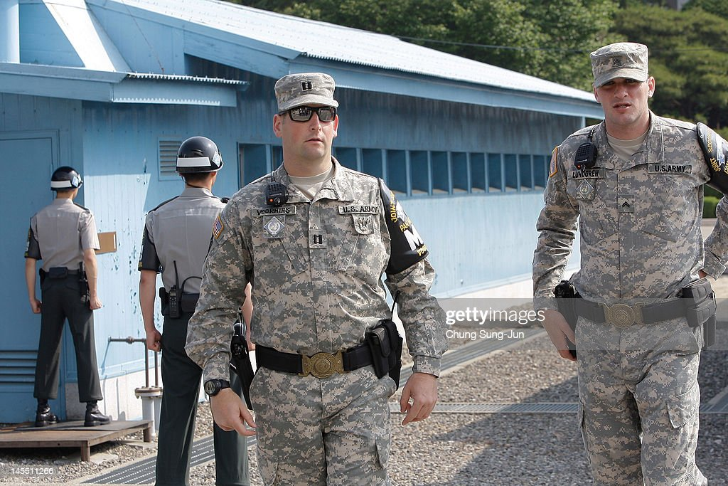 U.S. soldiers stand guard as King Carl XVI Gustaf of Sweden and Queen Silvia of Sweden visit at the border village of panmunjom between South and North Korea in the demilitarized zone (DMZ) on June 1, 2012, South Korea. The Swedish royals are on the four-day tour to South Korea.