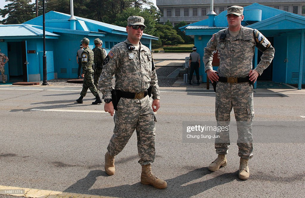 U.S. soldiers stand guard as King Carl XVI Gustaf of Sweden and <a gi-track='captionPersonalityLinkClicked' href=/galleries/search?phrase=Queen+Silvia+of+Sweden&family=editorial&specificpeople=160332 ng-click='$event.stopPropagation()'>Queen Silvia of Sweden</a> visit at the border village of panmunjom between South and North Korea in the demilitarized zone (DMZ) on June 1, 2012, South Korea. The Swedish royals are on the four-day tour to South Korea.