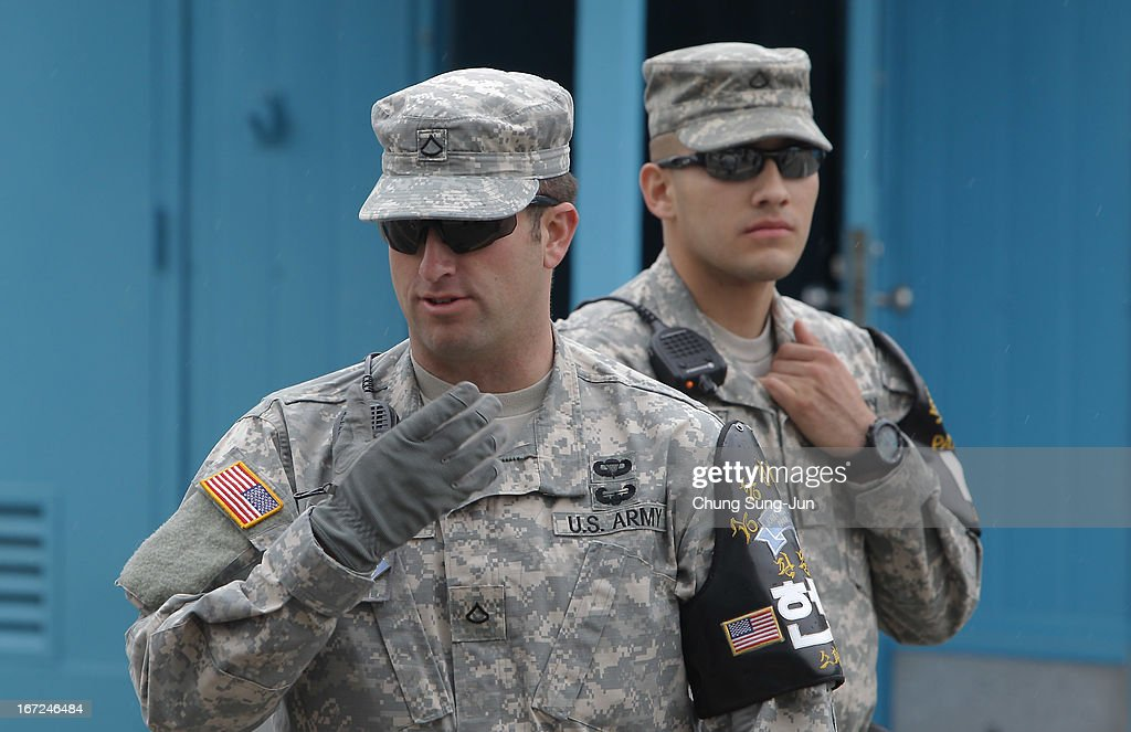 US soldiers stand guard at the border village of Panmunjom between South and North Korea at the Demilitarized Zone (DMZ) on April 23, 2013 in Panmunjom, South Korea. The tension at Korean Peninsula remains high as North Korea's ballistic missiles have been ready to launch ahead of North Korean Army foundation celebration day on April 25.