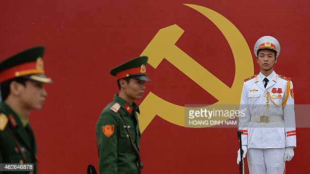 Soldiers stand guard at the entrance gate of the National Convention Center where Communist Party members have gathered for an official meeting...