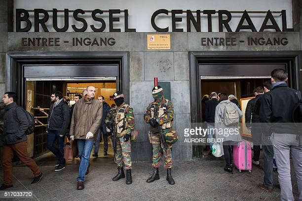 TOPSHOT Soldiers stand guard at the entrance of Brussels' central station on March 23 2016 one day after the attacks on Brussels airport and at a...