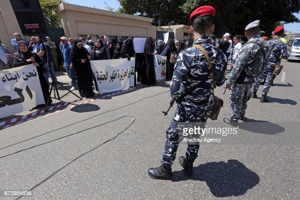 Soldiers stand guard during a protest against postponement of Ahmad AlAssir's trial in Beirut Lebanon on April 25 2017 Protesters including relatives...