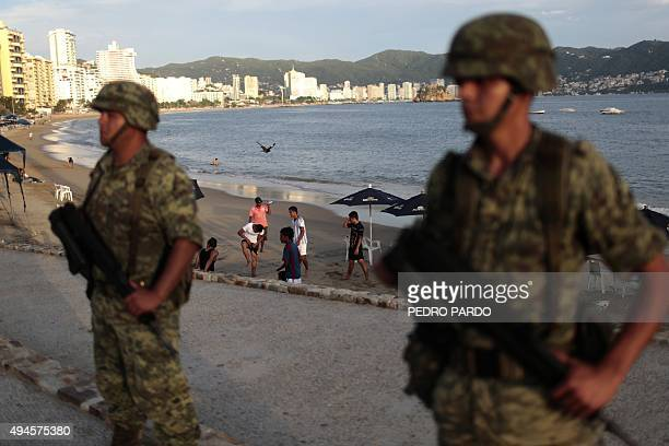Soldiers stand guard in a touristic area of Acapulco in the Mexican state of Guerrero on October 27 2015 Acapulco once known as a celebrities refuge...