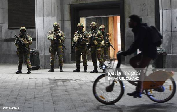 Soldiers stand guard in front of the Brussels Central Train Station on November 22 2015 as the Belgian capital remained on the highest security alert...