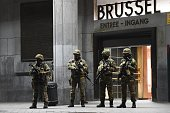 Soldiers stand guard in front of the central train station on November 22 2015 in Brussels as the Belgian capital remained on the highest security...