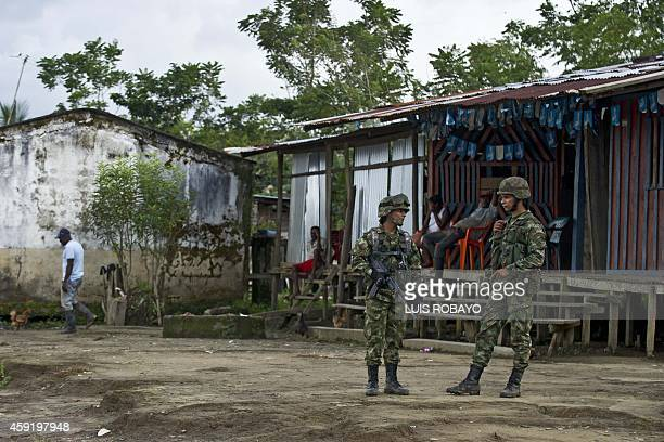 Soldiers stand guard in Las Mercedes rural area of Quibdo Department of Choco Colombia on November 18 where Colombian General Ruben Alzate was...
