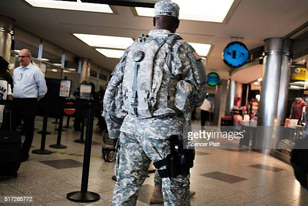 S Soldiers stand guard LaGuardia airport on March 24 2016 in New York City Following the deadly terrorist attacks in Brussels airports and train...