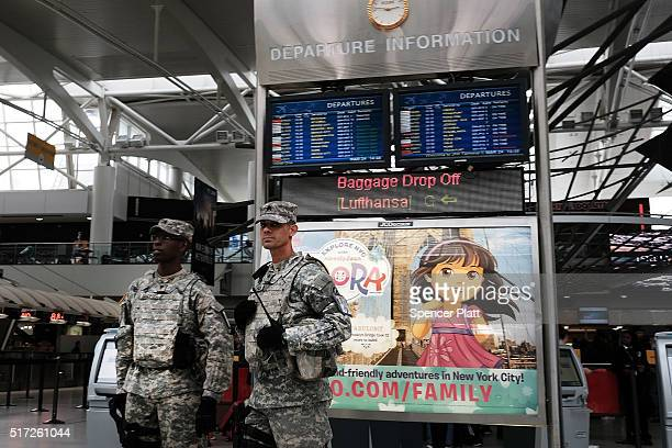 S Soldiers stand guard near a security line at John F Kennedy Airport on March 24 2016 in New York City Following the deadly terrorist attacks in...