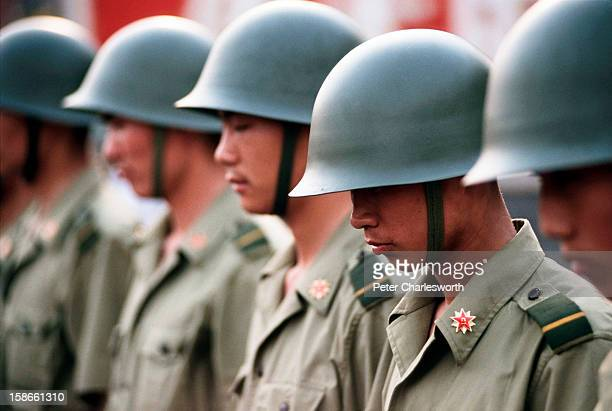 Soldiers stand guard outside the Chinese Communist Party's headquarters on Chiangan Avenue to keep back prodemocracy demonstrators just days before...