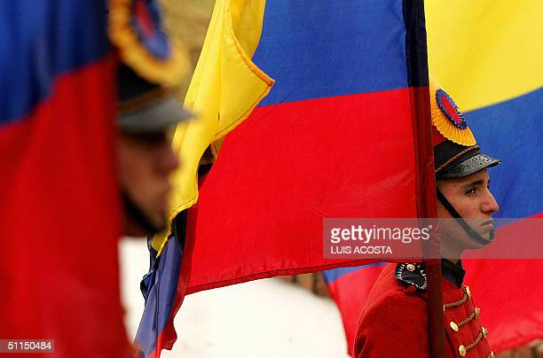 Soldiers stand guard with Colombian flags 07 August 2004 at Boyaca bridge during the celebrations to commemorate Colombia's independence from Spain...