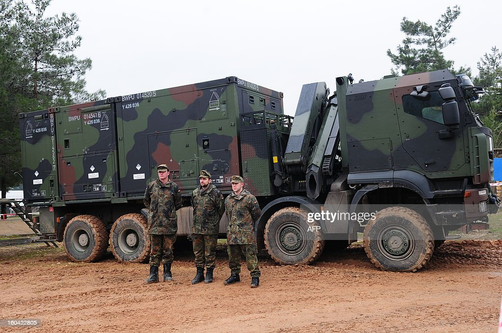 Soldiers stand in front of a Patriot system at a Turkish military base in Kahramanmaras on January 31, 2013. A second pair of Patriot missile batteries being sent by NATO countries to defend Turkey against possible attack from Syria are now operational, a German security official said on January 29, 2013. The United States, Germany and the Netherlands each committed to sending two batteries and up to 400 soldiers to operate them after Ankara asked for help to bolster its air defences against possible missile attack from Syria. The two German batteries, which have been deployed around the Turkish city of Kahramanmaras some 100 km (60 miles) from the Syrian border, were in position and ready to use, the German security official said.