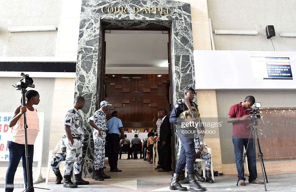 Soldiers stand in front of the entrance of the appeal court of Abidjan during Ivory Coast's former first lady trial on May 31, 2016. Simone Gbagbo goes on trial for crimes against humanity in what many see as a litmus case for justice in the West African country. The hearings into the 66-year-old's role in post-election carnage in 2010 is expected to last a month with 32 witnesses testifying. / AFP / ISSOUF