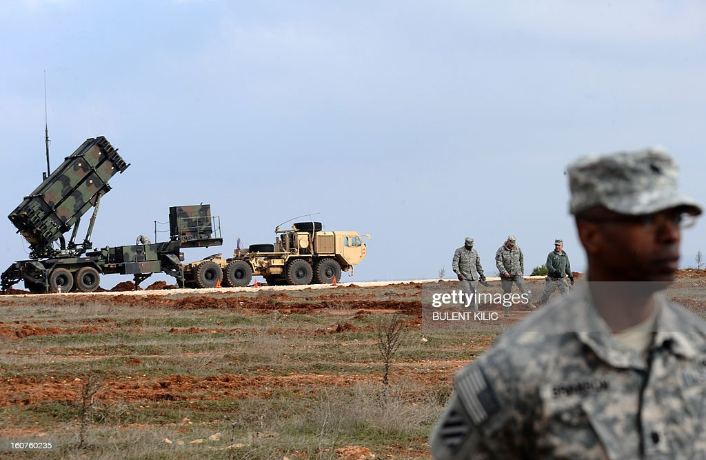 US soldiers stand near a Patriot missile system at a Turkish military base in Gaziantep on February 5 2013 The United States Germany and the...