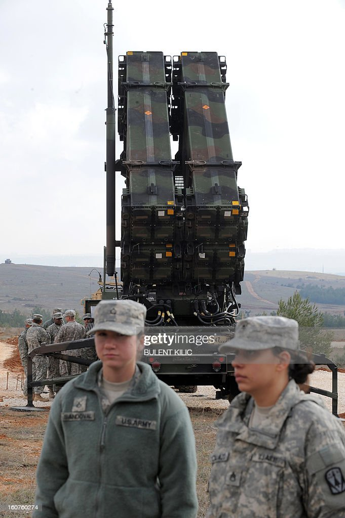 US soldiers stand near a Patriot missile system at a Turkish military base in Gaziantep on February 5, 2013. The United States, Germany and the Netherlands committed to send two missile batteries each and up to 400 soldiers to operate them after Ankara asked for help to bolster its air defences against possible missile attack from Syria. AFP PHOTO / BULENT KILIC