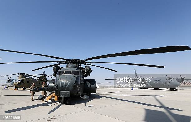 US soldiers stand near a Sea Dragon helicopter displayed at the Dubai Airshow on November 8 2015 Dubai Airshow took off today to a slow start amid...