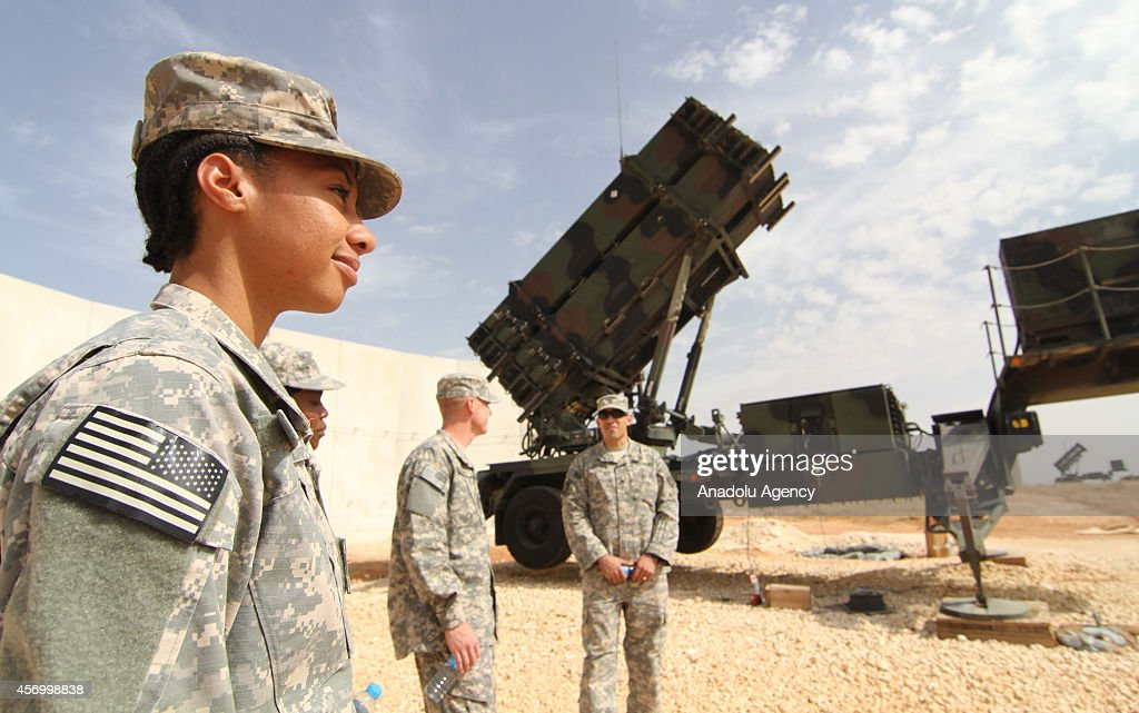 Soldiers stand near the Patriots as the NATO Secretary General's visit to US Patriot Battery Troops at the 5th Battalion in Turkeys Gaziantep...