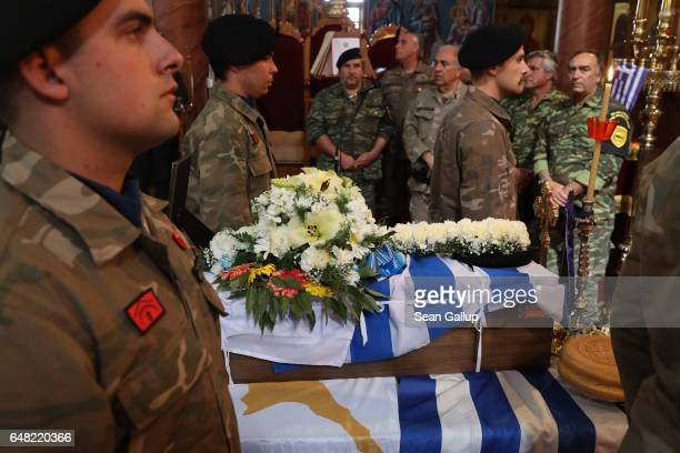 Soldiers stand next to the small coffin that contains the remains of Georgiou Theodoulos Theodoulou at his Orthodox funeral service on March 5 2017...