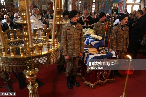 Soldiers stand next to the small coffin that contains the remains Georgiou Theodoulos Theodoulou at his Orthodox funeral service on March 5 2017 in...