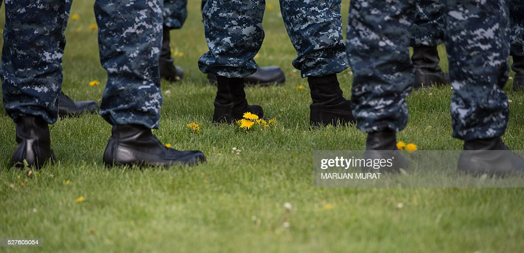 US soldiers stand on a meadow at the United States European Command (EUCOM) on May 3, 2016 at the Patch Barracks in Stuttgart, southern Germany. A ceremony took place at the barracks as US General Curtis Scaparrotti was introduced as Commander of the US European Command, taking over from US General Philip Breedlove. / AFP / dpa / Marijan Murat / Germany OUT