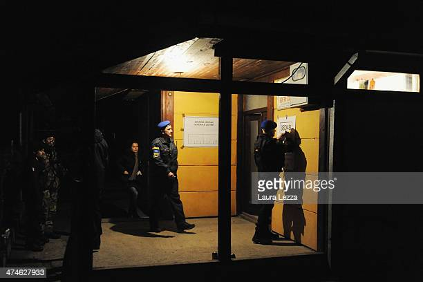 Soldiers stand outside a polling station during elections in Mitrovica North to elect the Mayor on February 23 2014 in Mitrovica Kosovo The candidate...