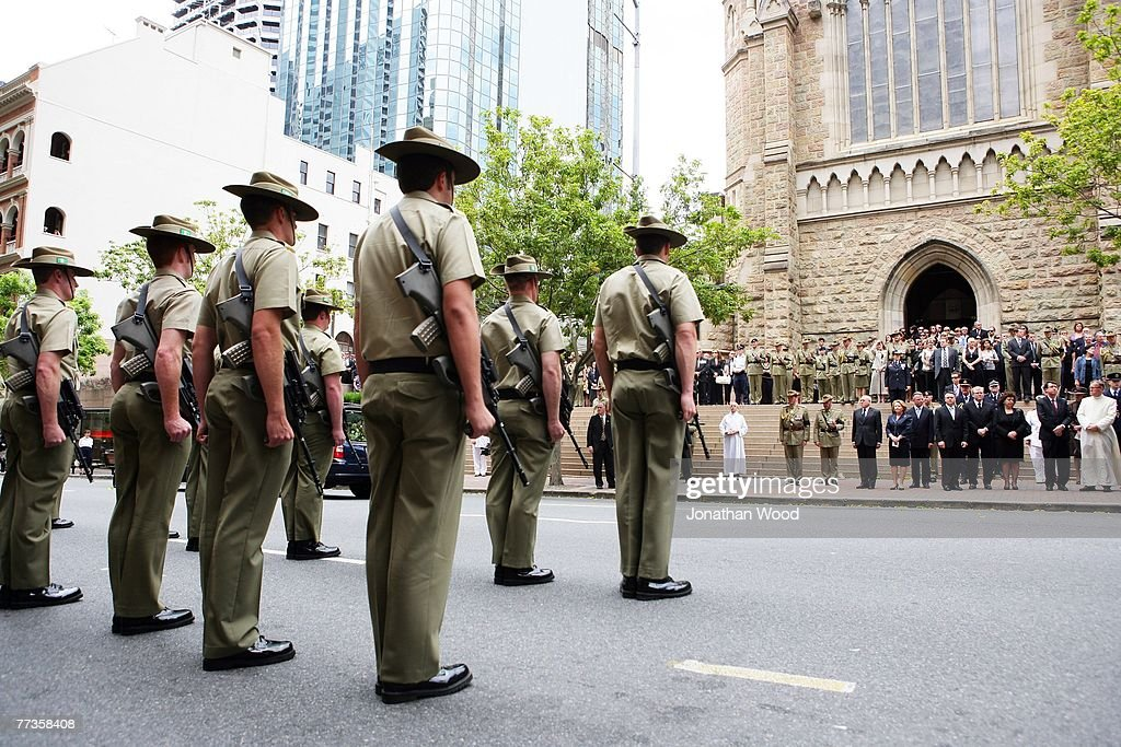 Soldiers stand to attention after the military funeral for Trooper David Pearce at the Cathedral of Saint Stephen on October 17 2007 in Brisbane...