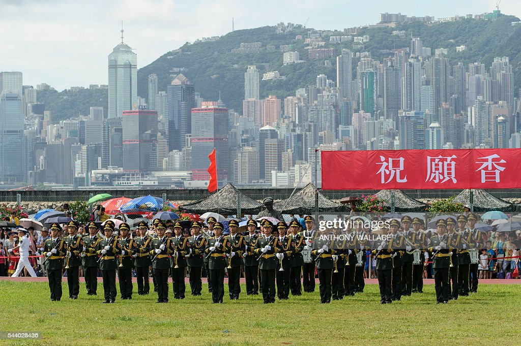 PLA soldiers stand to attention during the open day of the Chinese People's Liberation Army (PLA) Navy Base at Stonecutter Island in Hong Kong on July 1, 2016, to mark the 19th anniversary of the Hong Kong handover to China. / AFP / Anthony Wallace