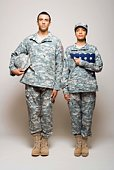 Soldiers standing with folded American flag