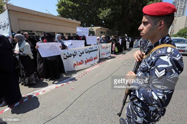 A soldiers stands guard during a protest against postponement of Ahmad AlAssir's trial in Beirut Lebanon on April 25 2017 Protesters including...