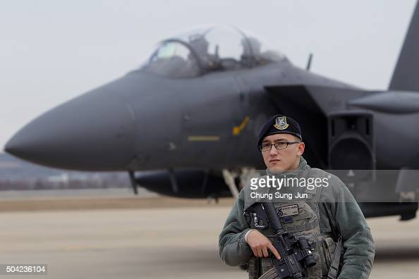 S soldiers stands guard in front of F15K at Osan Air Base on January 10 2016 in Pyeongtaek South Korea South Korea and the United States have...