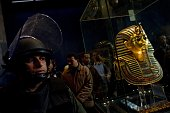 A soldiers stands guard next to Tutankhamun's gold funerary mask inside the Egyptian Museum as Egyptian state minister of antiquities Zahi Hawass...