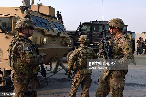 US soldiers stands guards at the scene of a suicide car bomb attack on a European Union police vehicle along the KabulJalalabad road in Kabul on...