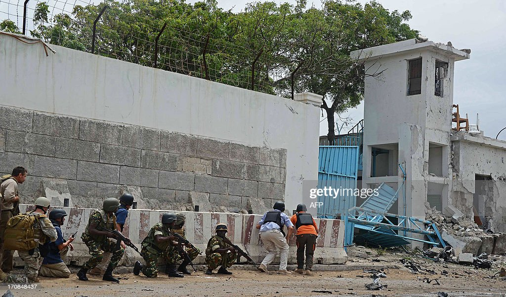 AMISOM soldiers take cover after Al-Qaeda linked Shebab insurgents shot and blasted their way into the United Nations (UN) compound in Mogadishu on June 19, 2013. It is the most serious attack on the UN in the troubled country in recent years. Three foreigners and at least two Somali security guards were killed during an attack by Islamist insurgents on a United Nations compound in Mogadishu UN sources were quoted as saying.