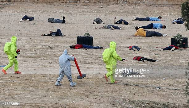 Soldiers take part in a defence drill simulating a chemical attack at an army camp in Zarqa city 30 kilometres east of the Jordanian capital Amman on...