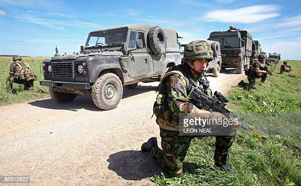 Soldiers take part in a mission rehearsal exercise by the 3 Commando Brigade on Salisbury Plains Wiltshire southern England ahead of their August...