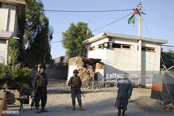Soldiers take security measures and inspect the area after Taliban raid on police headquarters in Afghanistan's eastern Nangarhar province leaving at...
