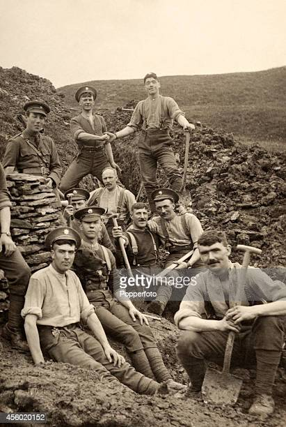 Soldiers taking a break from digging trenches during World War One circa 1914