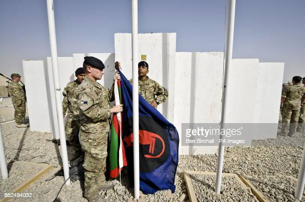 Soldiers tasked with flag raising duties behind the scenes during the transfer of authority ceremony at Camp 501 Camp Bastion Helmand Province in...