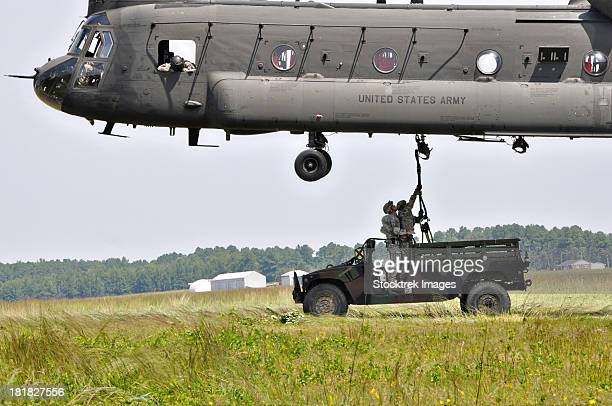 Soldiers teach students sling load operations on a CH-47 Chinook.