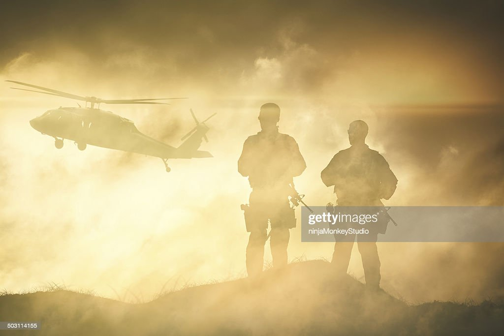 Soldiers wait for a Helicopter in Dust Storm : Stock Photo